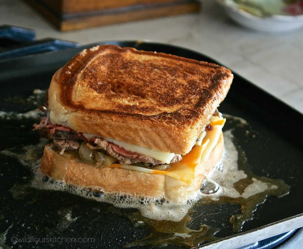 steak grilled cheese side 1 done